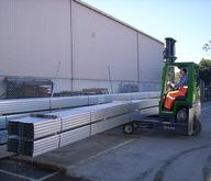 Combilift Offloading Long Tubular Bundles At A Steel Yard