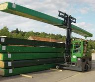 Combilift Long Loads of Wood Products Being Stored Outside